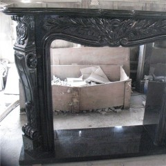 Black galaxy granite fireplace