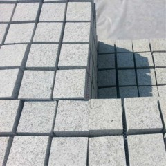Grey granite patterned floor tiles