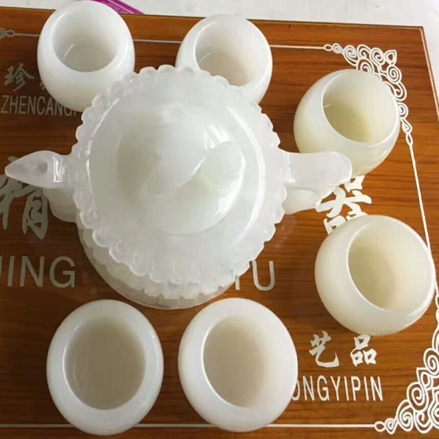 white jade tea pot and cups