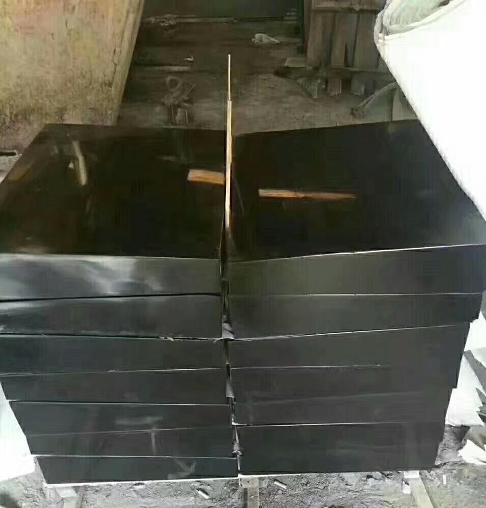 polished black basalt tiles
